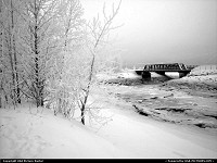 Cold and desolate rail bridge over Ship Creek in Anchorage Alaska.