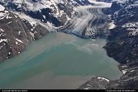 During a flightseeing tour over Glacier Bay NP we had a dramatic view at the 12-mile-long John Hopkins Glacier. The glaciers seen here today are remnants of a general ice advance- the Little Ice Age- that began about 4,000 years ago. In 1890, geologist Harry Fielding Reid discovered the glacier and proudly named it toe John Hopkins, a philanthropist and founder of the eponymous university and hospital. He also named the smaller glacier on the left to Daniel Coit Gilman, the first president of the university. For more backgroundstories and Alaska webgalleries: www.michelhammann-photography.com