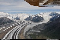 Streams of ice from the Kenicott Glacier and the Root Glacier flow together like rivers, forming glacier complexes that cover hundreds and hundreds of square miles in Wrangell-St.Elias National Park (Alaska). Shot made on a flight from Chitina to Mc. Carthy in the heart of the National Park. For more webgalleries: www.album-editions.nl & www.alaska-editions.nl
