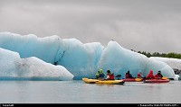 Iceberg, calved from Valdez Glacier (Alaska) thrills kayakkers in Lake Valdez. For more Alaska web galleries: www.alaska-editions.com