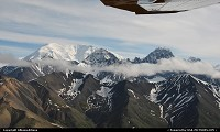 Wrangell-St. Elias National Park is by far the largest of America's national parks—almost six times the size of Yellowstone. You fly over it and see mountains beyond mountains, glaciers after glaciers, rivers upon rivers. Four major mountain ranges converge here: the Wrangells, the Alaska, the Chugach, and the St. Elias. Together they contain 9 of the 16 highest peaks in the United States For more Alaska and US web galleries: www.michelhammann-photography.com