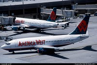 America West at home at Sky Harbour, a Boeing 737-200 taxies to gate past a stablemate in the shapes of a newer Airbus A320-200. Using