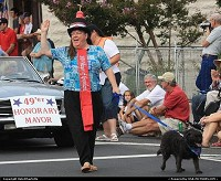 Mayor Goose (the dog) leads annual 49er Festival Town Parade with Lynn Upthagrove, owner of HOtel & Cafe Charlotte