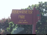 Long Beach : Park sign in Long Beach of which name is Rosie the riveter.Rosie the riveter is the symbol who represents the 6 million American women who worked in the industry during the World War II
