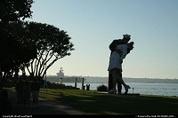"""Unconditional Surrender by F. Seward Johnson. This 25-foot tall sculpture celebrates the """"triumphant moments"""" of the Greatest Generation. The iconic image of the sailor kissing the young nurse in Times Square, New York City on August, 14, 1945 captured the joy and euphoria with the public announcement of the end of World War II. On temporary loan there, from the Sculpture Foundation. In front of the USS Midway 41."""