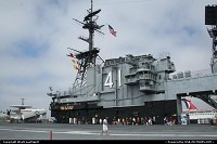 USS Miday, the famous aircraft carrier, now decommissioned and docked at the Broadway Pier in dowtown San Diego. The ship is now a museum. One could tour it, including hanger bay (hudge!), mess hall, flight control center, flight deck and more.