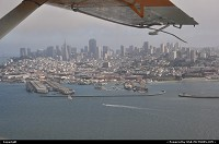 Overlooking downtown San Francisco from the seaplane, flying around bay area on a foggy weather.