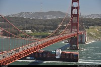 , San Francisco, CA, Another ship sailing into the bay with its precious, massive payload of goods coming from elsewhere in the World, most likely Asia. San Francisco end of the bridge looks funny, just like if the span drives you toward a dead end!