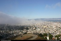 Overview of the city from Twin Peaks. Market Street clearly visible over the fog.
