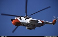 A US.Coast Guard Sikorsky HH.3 hovering above the Golden Gate Bridge Park while patrolling the seashores in search of some lost souls to save.