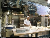 baker at work behind the glass of BOUDIN bakery (fisherman's wharf)
