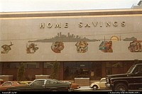 San Francisco : Home Savings' distinctive front view. On the pavement, US-built cars still rule the traffic despite some objection from a lone VW Beattle.