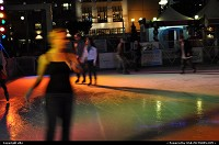 ice rink, at san francisco during christmas time, kind of wife beater shirt, wear by this woman ...well california
