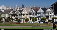 Painted Ladies in San Francisco with downtown/financial district afar.