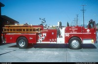 Another roofless fire engine resting between two missions