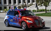 , Denver, CO, All American PT Cruiser parading in front of the City all in downtown Denver.