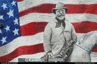 Wall painting featuring a gentleman in front of the American Flag. Situated opposite of the Colorado Convention Center, downtown Denver