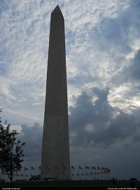 Washington Memorial flocked by amazing clouds