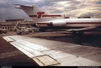 Passenger's perspective on classic National's terminal on the garden side from a pushing back Trump Shuttle Boeing 727, while a sister-ship just arrived from New York/La Guardia.
