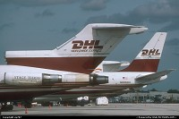 Florida, One of the numerous cargo ramps playing host to a DHL's 727-200(F), a stablemate in the shapes of a Douglas DC.8-73CF and a Quest Airways