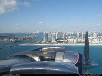 HISTORICAL FLIGHT FOUNDATION DC-7 N836D wearing her original 1958 color scheme. Flight out of Opa Locka on January 15 2011 Miami Skyline in the background, Fischer island and South Beach in the foreground.