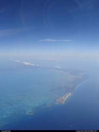 Out of Miami, a few minutes after take-off, Grand Bahama spreads on the Atlantic Ocean.