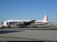 HISTORICAL FLIGHT FOUNDATION DC-7 N836D wearing her original 1958 color scheme. Flight out of Opa Locka on January 15 2011