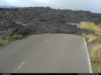 Lava stream spreading over the road