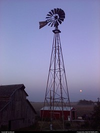 Turn of the century barn and windmill with the rising moon. I loved the colors of the sky.