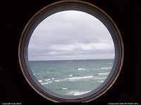 Looking through a window, in the Big Sable lighthouse, out to Lake Michigan