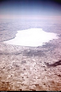 Not in a city : Prime view on a snow capped landscape doted by frozen lakes while en route from Newark/NJ to Minneapolis-St Paul on board a Northwest Airlines DC.9-51.