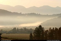 Montana, Glowing, misty sunrise in Smith Valley near Kila, Montana.