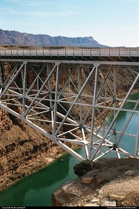 Not in a city : The Navajo Bridge crosses Colorado River over the Marble Canyon. It is the bridge crossing th river in almost 600 miles / 1 000 km. Construction began in 1927 and became part of the US Road 89A. A similar yet wider arche was build on 1995 to accomodate trafic and improve security.