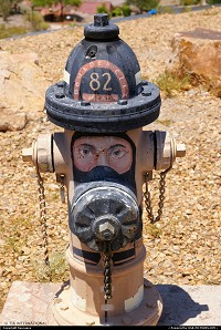 Swelter & Hydrant A painted fire hydrant at a hill overlooking Boulder City and Lake Mead, Nevada. I wanted to unfasten it because it was already over 100F by the time I reached this point on my trip to Hoover Dam! Luckily, I had a lot of bottled water in the car.