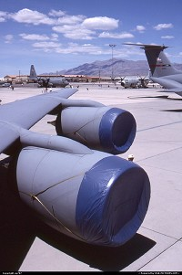 Nevada, Playing their acts during the USAF's 50 years openday. The engines belong to a Boeing KC-135R tanker/transport aircraft, the T-tail section hints a Lockheed C.141 Starlifter cargo aircraft parked alongside. Afar are two of the numerous Lockheed C.130 Hercules also taking part in the event.