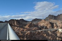 Overview of the Hoover Dam from the new built Bypass Bridge. Look how hostile the topography is! Quite an achievement to have built this marvel of engineering in the 30's ... It took 4 years to erect the damn (1931-1935) and 5 to complete the bypass (2005-2010) The later was completed at a cost of $240 M, which happens to be the initial budget. Let's call that an achievement :)