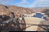 Nevada, Overview of the Hoover Dam from the new built Bypass Bridge. Look how hostile the topography is! Quite an achievement to have built this marvel of engineering in the 30's ... It took 4 years to erect the damn (1931-1935) and 5 to complete the bypass (2005-2010) The later was completed at a cost of $240 M, which happens to be the initial budget. Let's call that an achievement :) New Bypaas bridge reflects its shape on the dam, nice!