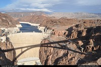 not in a city : Interesting composition here. The Lake Mead is afar, contained by the impressive Hoover Dam. The new built I93 iconic bridge (aka Hoover Dam bypass) reflects its majestic structure right in the dam. The bridge is named Mike O'Callaghan – Pat Tillman Memorial Bridge