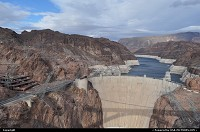not in a city : Overview of the Hoover Dam complex, close to the Mike O'Callaghan – Pat Tillman Memorial Bridge. Project I93 bypass. The dam sits right on the Nevada/Arizona border. Look how hostile the environnement is. That construction is an engineering marvel.