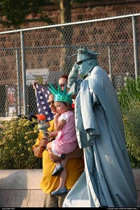 Photo by elki | New York  New york human statue of liberty