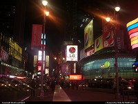 Another view of Times Square by night. Plenty of neons and billboards around.