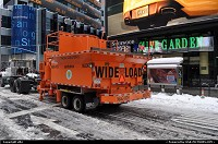 New-york, what that hell is this machine. I asked myself first time i saw it. Simple when the snow covering all manathan street ... Then the deal is simple, you block a street, stock all neighborhood snow in that street. Then this big orange machine will melt it , and dump water into sewer, simple !!