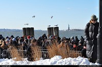 Waiting in a very cold wind to visit miss liberty !!