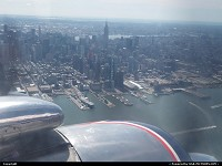 , New York, NY, Flying over New York aboard Historical Flight Foundation DC-7B N836D in Eastern Airlines livery.