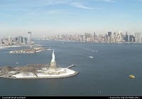 New York : Great Manhattan overview form the helicopter, with Statue Of Liberty. New Jersey to the left.