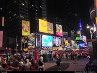 New York : New York times square crowded on that Friday evening.