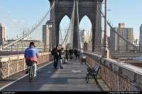 text from wikipedia, find more :http://en.wikipedia.org/wiki/Brooklyn_bridge The Brooklyn Bridge is one of the oldest suspension bridges in the United States. Completed in 1883, it connects the New York City boroughs of Manhattan and Brooklyn by spanning the East River. At 5,989 feet (1825 m),[2] it was the longest suspension bridge in the world from its opening to 1903, the first steel-wire suspension bridge, and the first bridge to connect Manhattan to the mainland. Originally referred to as the New York and Brooklyn Bridge, it was dubbed the Brooklyn Bridge in an 1867 letter to the editor of the Brooklyn Daily Eagle,[3] and formally so named by the city government in 1915. Since its opening, it has become an iconic part of the New York skyline. It was designated a National Historic Landmark in 1964