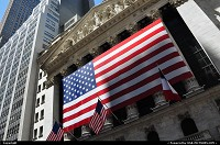 Famous Wall Street / NYSE entrance, with the USA flag streched-on. Do you notice the French flag waving on New Today? (07/14/2011)