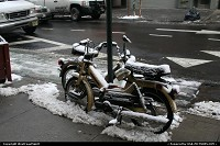 Moped under the snow in Chinatown, Manhattan.