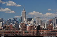 New york : The proud and georgous Empire State Building here seen from Brooklyn bridge.